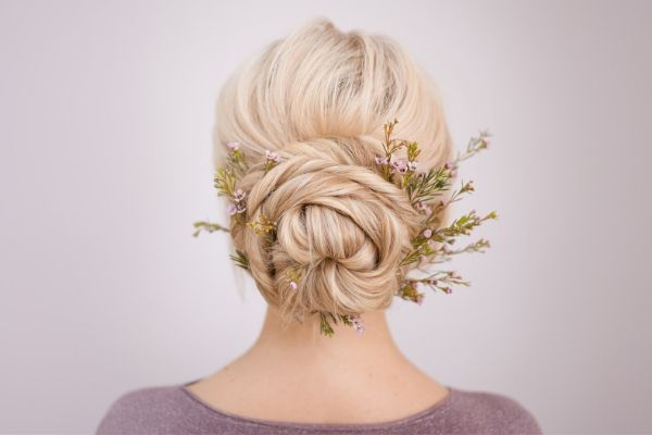 bridal hair accessory tips - Bride with natural foliage poking out of bun