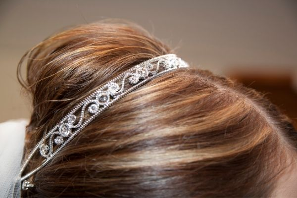 bridal hair accessory tips - silver veil headband sitting on a bun