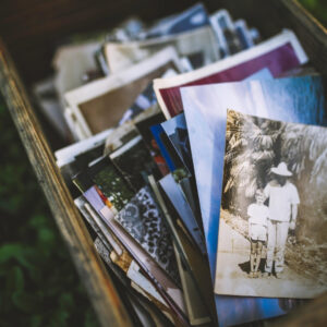 Box of photographs to be used in memorial table at wedding reception