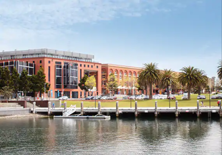 image from deaking.edu. au - Photo of campus buildings from across the water