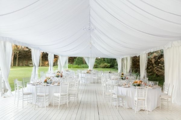 2021 Wedding Trends - open air marquee with small number of tables set up underneath